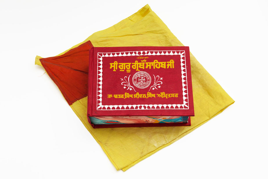 The picture shows the books cover, its red with yellow script